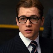 Hero of Kingsman: the Secret Service, Eggsy is wearing a bespoke suit and tie