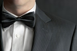 Gentleman wearing a bow tie to match dinner jacket lapels for a black tie event