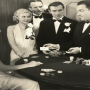 Gamblers dressed in black tie at a casino