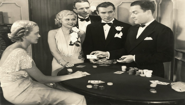 Gamblers dressed in black tie at a casino