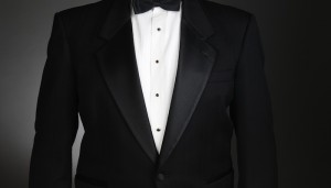 Man wearing dinner jacket before black tie event