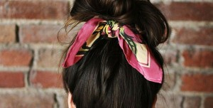 Woman using scarf as a hair bow